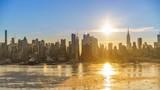 Midtown Manhattan skyline at sunrise in New York, timelapse of rising sun - 208025109