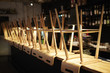 Wooden stools stacked upside down on bar counter at night