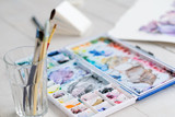 art painting leisure craft and hobby. drawing and creativity concept. watercolors and brushes on the desk - 208027597