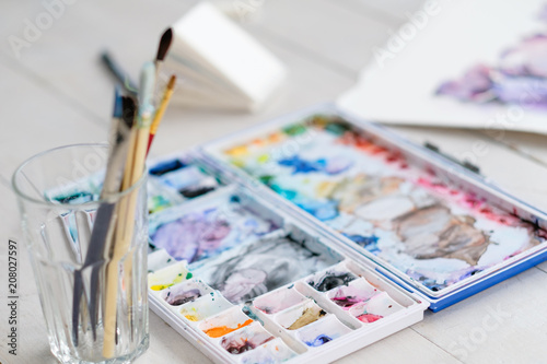 art painting leisure craft and hobby. drawing and creativity concept. watercolors and brushes on the desk