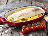Fish cod baked in the oven with potatoes, diet healthy food. Dark old wooden rustic gray background, side view - 208033367