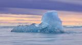 Iceberg from the Jokulsarlon glacial lagoon floating - 208033754