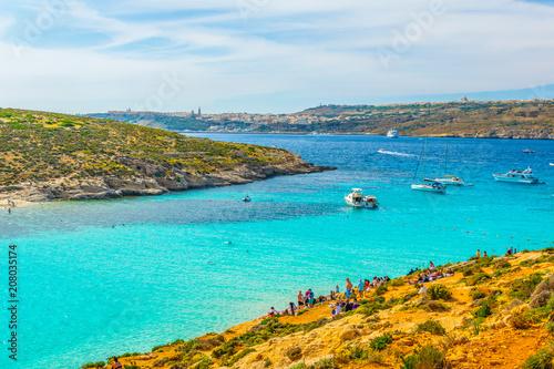 Fotobehang Turkoois Tourists are enjoying turquoise water of the blue lagoon on the comino island, Malta