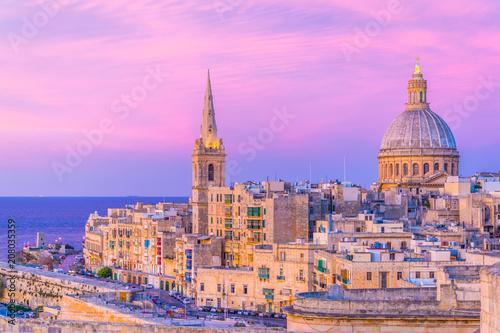 Fotobehang Purper Sunset view of the carmelite church Our Lady of Mount Carmel in Valletta, Malta