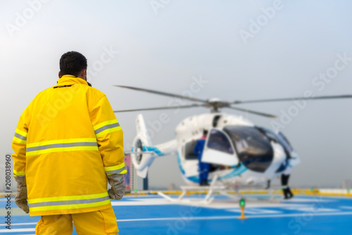Fototapeta helicopter landing officer and alarm for the air rescue service. Team of rescuers medical helicopter