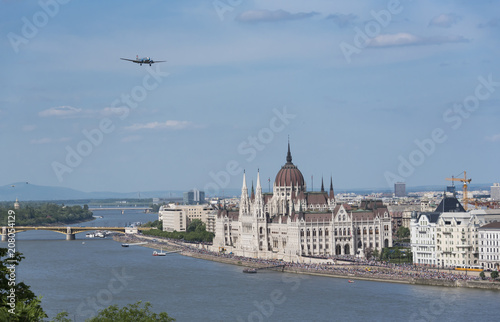 Fotobehang Boedapest The plane flies over the Danube river and Parliament building in Budapest on 01.05.2018 Hungary