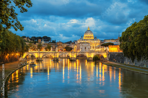 Evening view of Basilica St Peter and bridge Sant Angelo in Vatican City Rome Italy. Rome architecture and landmark.  St. Peter's cathedral in Rome.