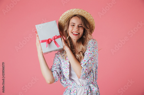 Leinwanddruck Bild Portrait of a satisfied young woman in summer dress