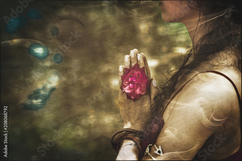 Plakat close up of yoga woman hands in namaste gesture with rose flower