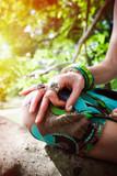 closeup of woman hand in mudra gesture practice yoga sit on tree - 208069173