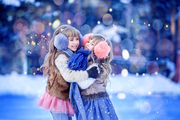 Girls, sisters skate on the ice rink and laugh