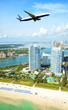 Airplane flying over Miami Beach, Florida