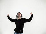 portrait of a energetic guy rapper on a light background - 208086781