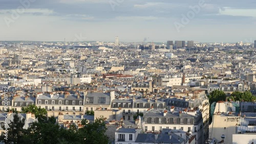 Poster Paris panoramic landscape view city buildings roofs from the top of Montmartre in evening