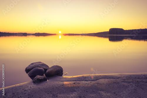 Plexiglas Geel Summer night sunset from Kuhmo, Finland.