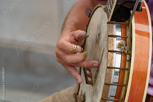Banjo player street performer in nyc - 208098557