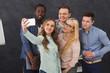 Business people making group selfie, having fun