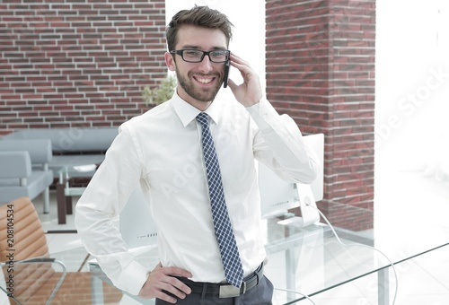 Poster Manager talking to a customer on the phone