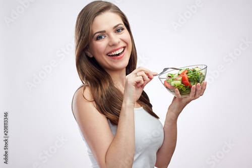 Foto Murales lifestyle isolated portrait of smiling woman holding green salad