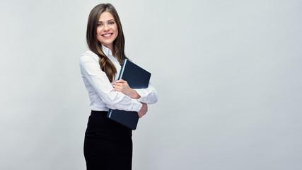 Business woman holding laptop. Isolated portrait © Yuriy Shevtsov