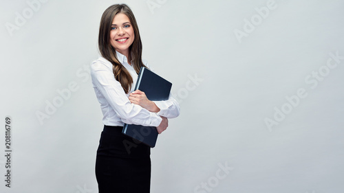 Business woman holding laptop. Isolated portrait - 208116769