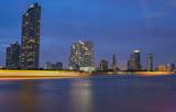 Modern building and Chao Phraya River at night. Traffic light by boat Bangkok Thailand