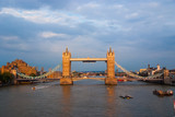 Tower bridge in London, United Kingdom. Bridge over Thames river on cloudy sky. Buildings on river banks with nice architecture. Structure and design. Wanderlust and vacation concept