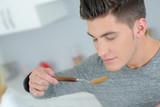 man eating soup - 208135394