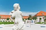 Sculpture of Cupid in the Baroque Summer Garden