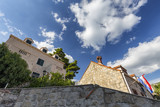 Croatian flag and traditional croatian buildings in Cavtat. - 208139366