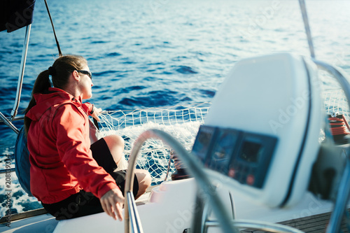 Fotobehang Zeilen Attractive strong woman sailing with her boat
