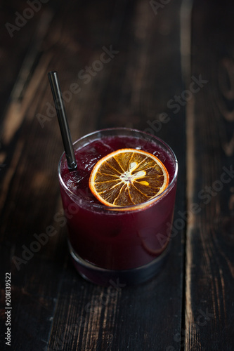 Fresh berry summer coctail with citrus slice