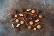 Chocolates, cinnamon, coffee beans and star anis on stone background