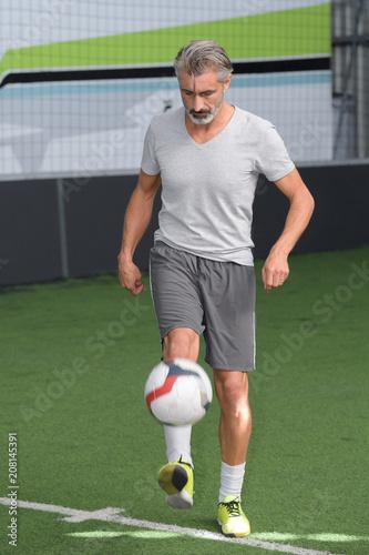 Leinwanddruck Bild football player with ball