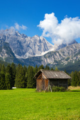 small wooden house in the mountains