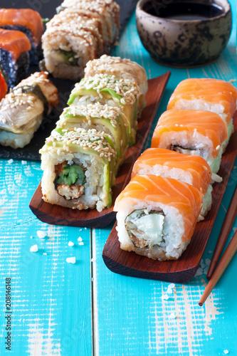 Aluminium Sushi bar Sushi set and chopstiks on wooden blue backgound