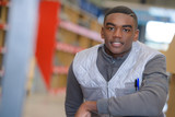 portrait of young man warehouse worker - 208148766