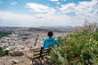 View of Athens and Acropolis (woman looking towards) from Lycabettus Hill (Mount Lycabettus), Athens Greece