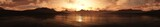 panorama of the sunset over the sea shore, rocky coast at sunset, sunset over the rocks, 3D rendering