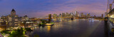 Brooklyn, Brooklyn park, Brooklyn Bridge, Janes Carousel and Lower Manhattan skyline at night seen from Manhattan bridge, New York city, USA. Wide angle panoramic image.