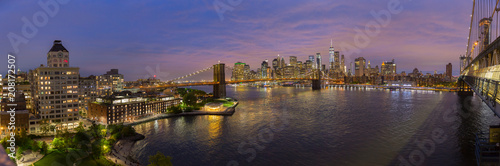 Brooklyn, Brooklyn park, Brooklyn Bridge, Janes Carousel and Lower Manhattan skyline at night seen from Manhattan bridge, New York city, USA. Wide angle panoramic image. - 208172507
