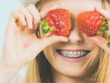 Young woman with fresh strawberries