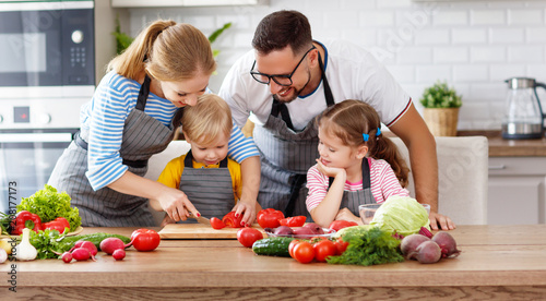 happy family with children preparing vegetable salad . - 208177173