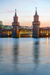 The Oberbaumbridge and the river Spree in Berlin after sunset