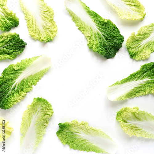 Plexiglas Peking Composition of the leaves of Peking cabbage, creative flat layout, top view.