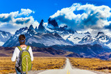 Woman with a backpack is standing to Mount Fitz Roy
