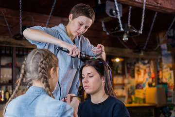 Make-up artist and hairdresser working with woman client © happy_finch