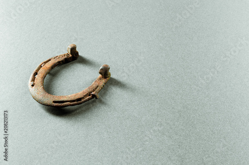 Leinwanddruck Bild Old rusty horseshoe
