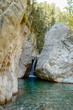 scenic view of waterfall between boulders and trees behind in Cappadocia, Turkey
