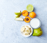 Fresh Ingredients for a Vegan Smoothie ( apricots, banana, pear, lime, mint and almond milk) - 208236339